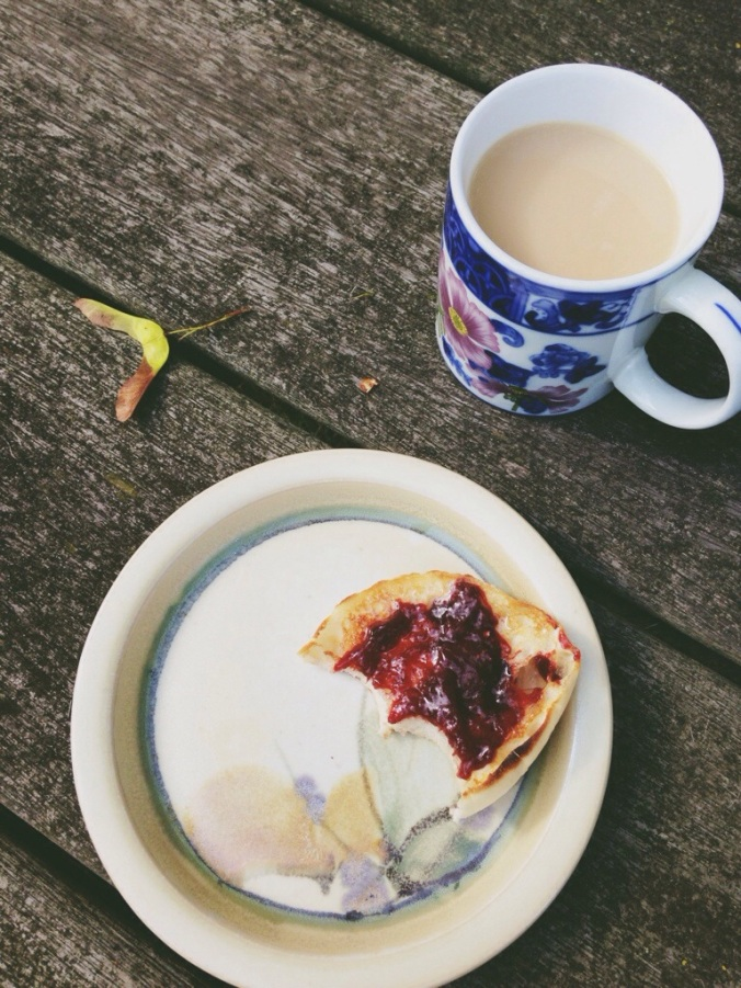 A perfect breakfast of tea and English muffins with homemade strawberry jam